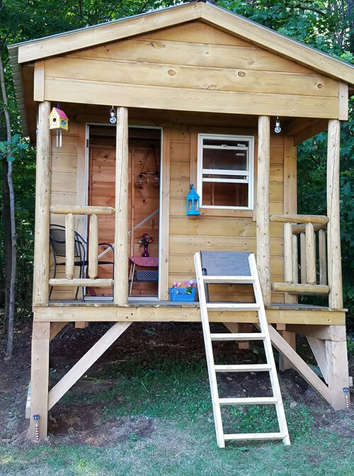 Create a wooden playhouse for kids with a storage shed!