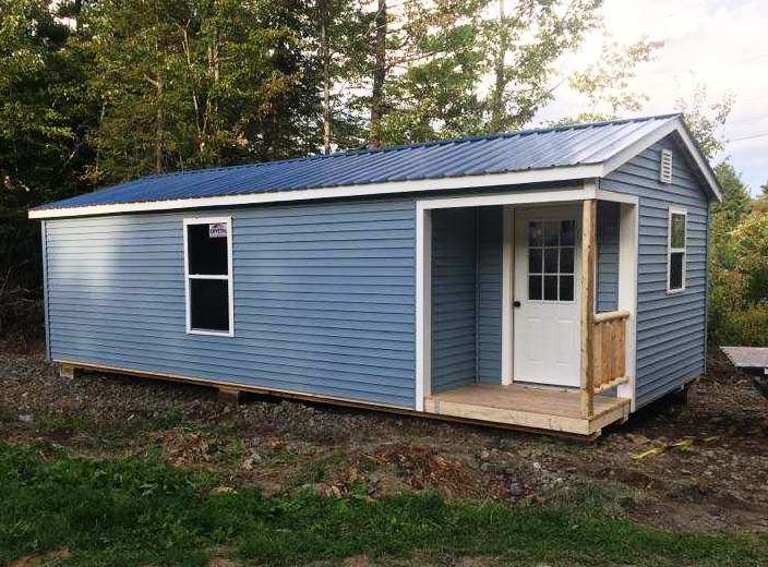 Outdoor shed with vinyl siding