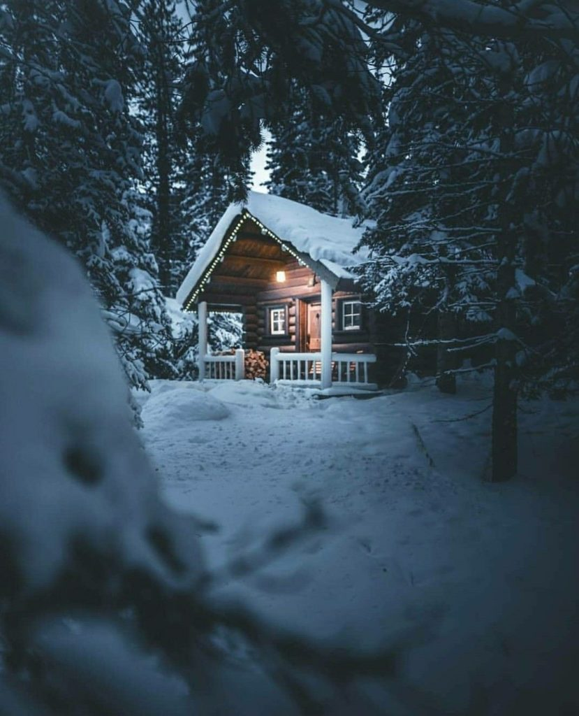 Winter cabin in the snow